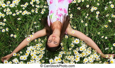 Girl on the field chamomile