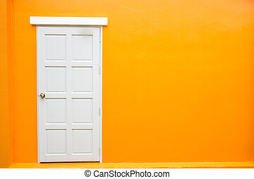 White door classic vintage on the color orange wall background
