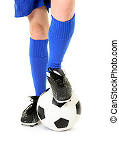 Boy with foot on soccer ball - A boy rests his foot on a...