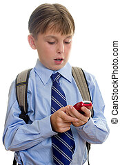 School boy child sms texting - A schoolboy student using a...