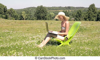 Woman sunbathing and working