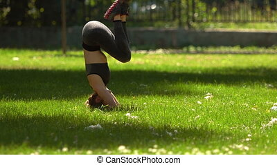 Pretty Girl is doing Yoga in Park - Pretty Girl is doing...