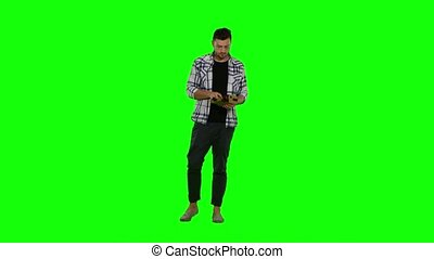 Man wearing virtuality googles. Green screen - Man wearing...
