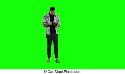 Surprised man uses virtual reality goggles. Green screen