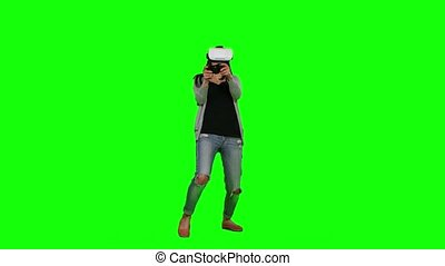 Girl plays virtual reality games. Green screen - Girl plays...