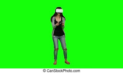 Surprised girl plays some virtual reality games. Green...