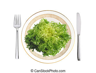 Cut savoy cabbage on plate, fork and knife isolated on white...