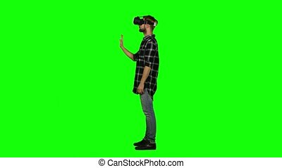 Man wearing virtual reality glasses. Green screen - Man...