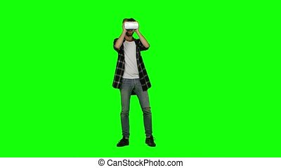 Man wearing virtual reality goggles Studio shot Green screen...