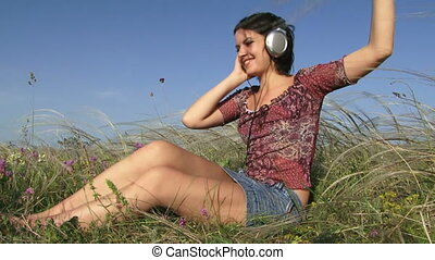 Funny girl listens to music