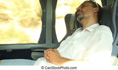Traveler man sleeping in a bus
