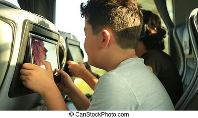 Child  playing video game on the bus
