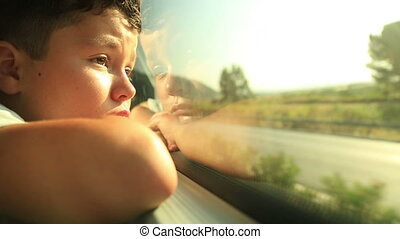 Boy Looking Out Window - Tired little boy travelling in bus...
