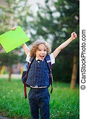 Little schoolboy rejoices.