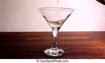 vermouth and olive in a glass