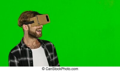 Augmented reality device creating virtual space for smartphone applications. Green screen. Close up