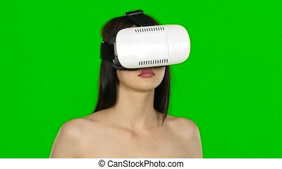 Woman turning her head with a VR virtual reality headset on....