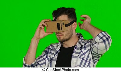 Virtual reality. VR glasses. Green screen. Close up -...
