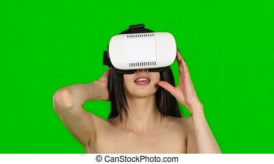 Woman using virtual reality headset, VR mask, close up....
