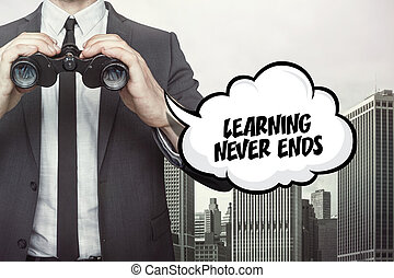 Learning never ends text on speech bubble with businessman...
