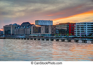 Sunset at the river Spree in Berlin with modern office...