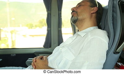 Man Sleeping In Bus - Tired, middle age business man...