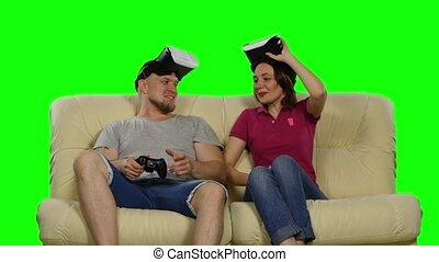 Couple Exploring Virtual Reality with VR Glasses Green...