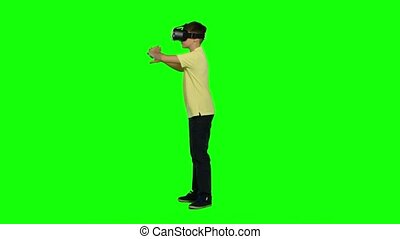 Virtual reality mask. Ghild uses head-mounted display. Green screen