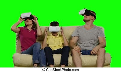Virtual reality. Green screen - Family using VR glasses...