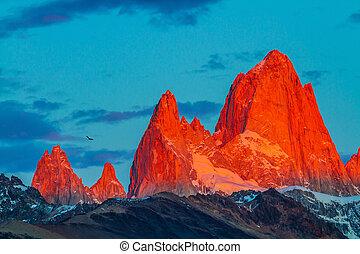 Fitz Roy illuminates the crimson sunset - Sharp tops...
