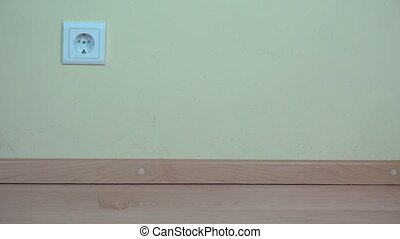 female hand plug iron wire to wall socket. - female hand...