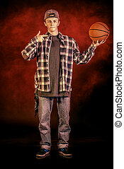 street dances - Trendy young man posing with basketball at...