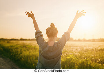 female teen girl stand feel freedom with arms stretched to...
