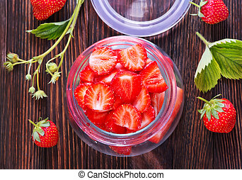 strawberry - fresh strawberry in glass bank and on a table