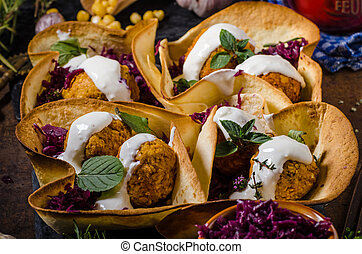 Falafel with herbs and cabbage - Falafel fried to golden in...
