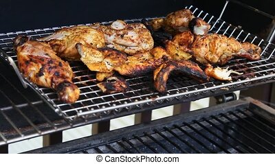 Grilled Tandoori Chicken cooking on a barbecue grill.