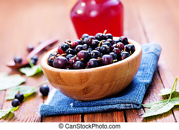 black currant in bowl and on a table