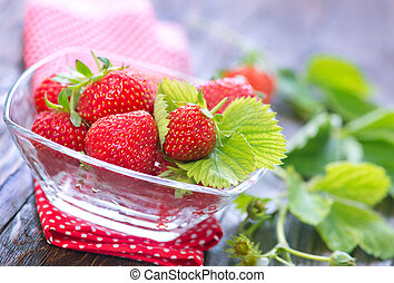 strawberry - fresh strawberry in bowl and on a table