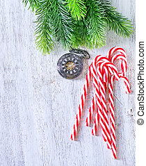 christmas background - candy canes on the white table,...