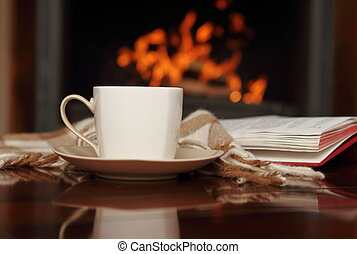 Tea by the fireplace - Tea, book and shawl by the fireplace