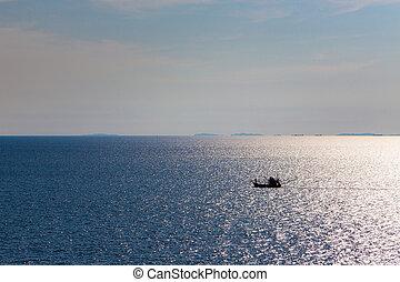 Fishing boat in ocean - Small long fishing boat in ocean...