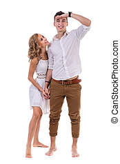 Cheerful young couple on white background, isolated - Happy...