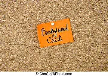 Background Check written on orange paper note