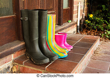 Colourful wellington boots left on a doorstep - Colourful...