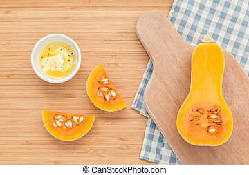 Fresh pumpkin and pumpkin slice with butter in the bowl for...