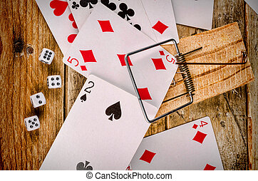 Gambling - Cards and dice in a conceptual shot depictiing...