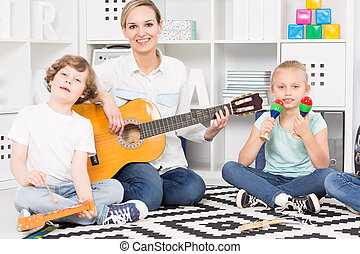 Playing their favourite song - Shot of a teacher playing a...
