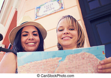 Women Travelling In Havana Cuba Reading Map In Calle Obispo...