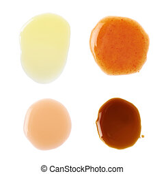 Four puddles of sauce isolated - Four puddles of hot pepper,...