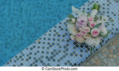 Bridal Bouquet near by Pool. Wedding day